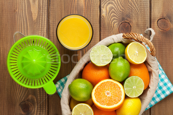 Fruits verre jus oranges citrons Photo stock © karandaev