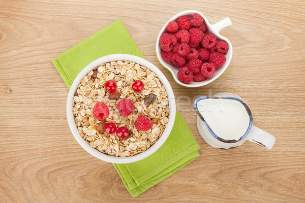 朝食 ミューズリー 液果類 ミルク 木製のテーブル 食品 ストックフォト © karandaev