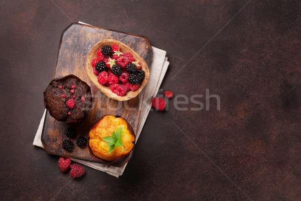 Muffins with berries and mint Stock photo © karandaev