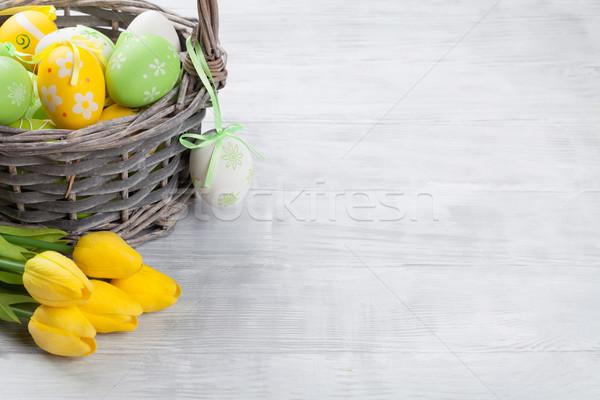 Easter eggs and tulip flowers Stock photo © karandaev