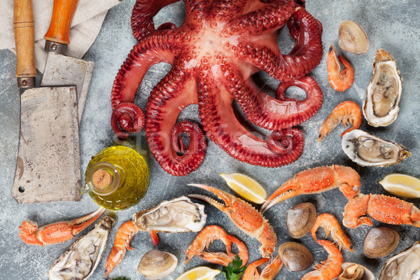 Seafood. Octopus, oysters, lobster, shrimps Stock photo © karandaev