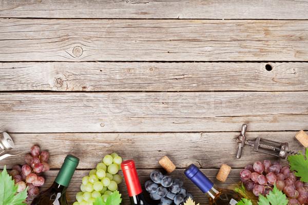 Wine bottles and grapes Stock photo © karandaev