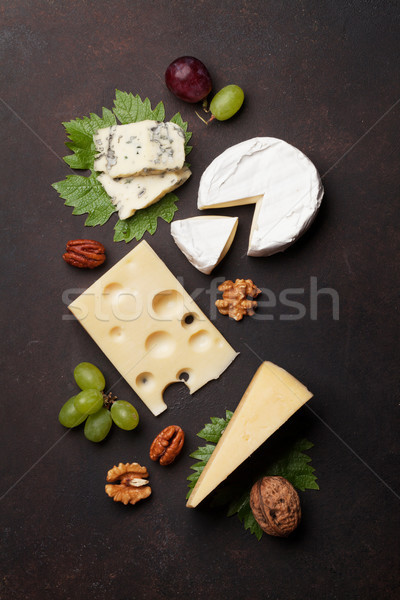 Cheese, grapes and nuts Stock photo © karandaev