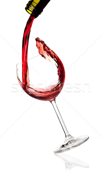 Wine collection -  Red wine is poured into a falling glass Stock photo © karandaev