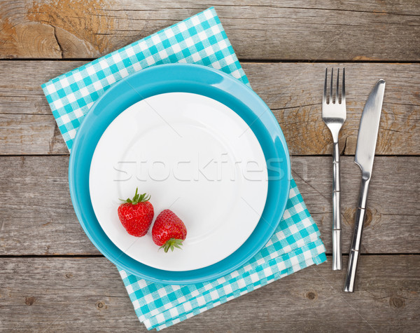 Plate with ripe strawberry and silverware Stock photo © karandaev