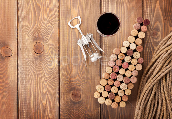 Wine bottle shaped corks, glass of red wine and corkscrew Stock photo © karandaev