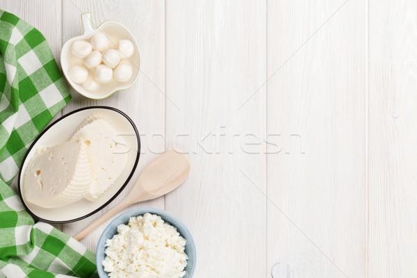Tejtermékek különböző sajt fa asztal felső kilátás Stock fotó © karandaev
