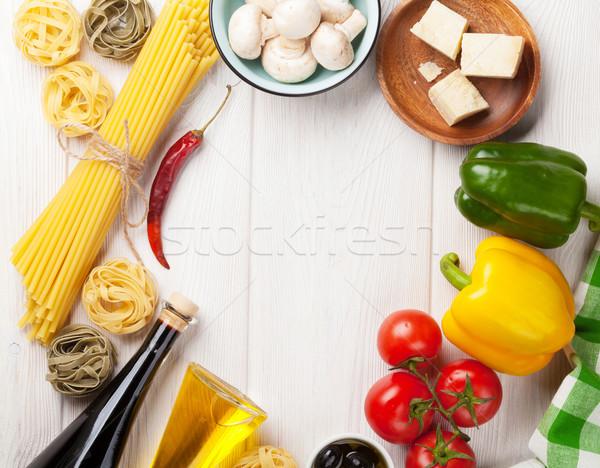 Italian food cooking ingredients. Pasta, tomatoes, peppes Stock photo © karandaev