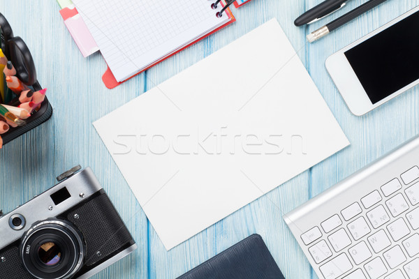 Office desk with supplies, camera and blank card Stock photo © karandaev