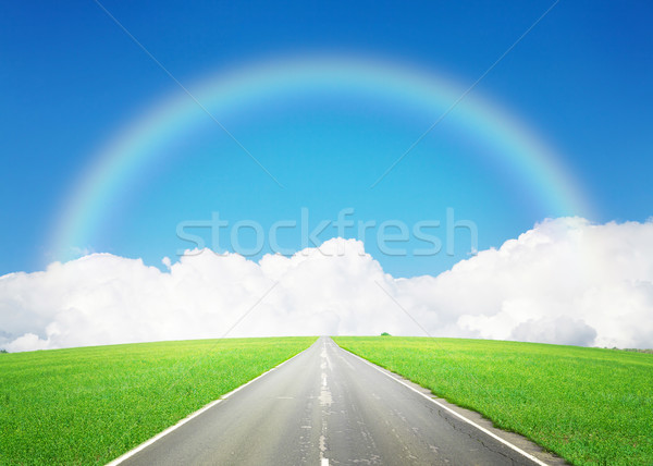 Road through the green field and sky with clouds and rainbow Stock photo © karandaev