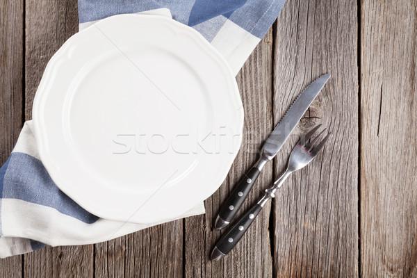 üres tányér ezüst étkészlet fa asztal felső kilátás Stock fotó © karandaev