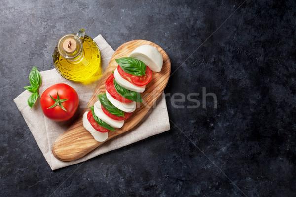 Caprese salatası mozzarella domates fesleğen peynir ot Stok fotoğraf © karandaev
