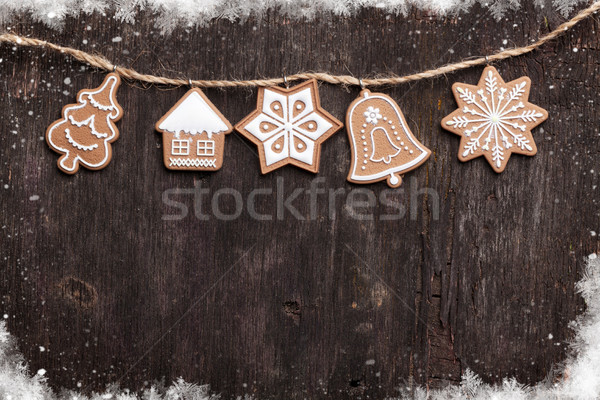 Christmas wooden background with gingerbread cookies Stock photo © karandaev