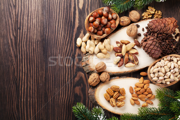 Various nuts on wooden table Stock photo © karandaev