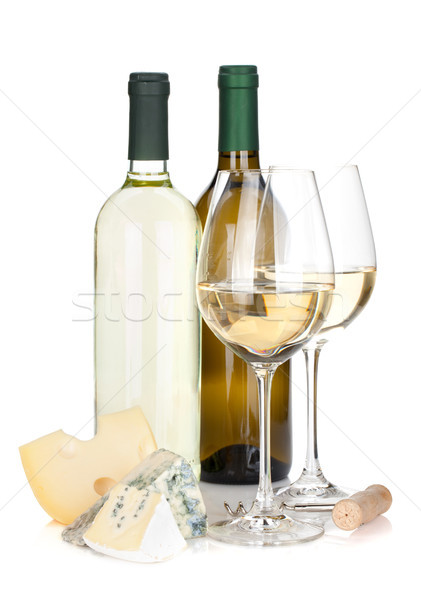 White wine bottles, two glasses, cheese and corkscrew Stock photo © karandaev