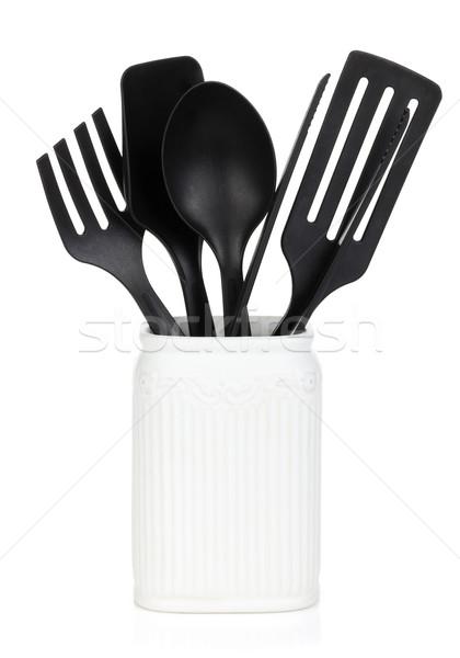 Kitchen utensils in holder Stock photo © karandaev