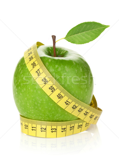 Fresh green apple with yellow measuring tape Stock photo © karandaev