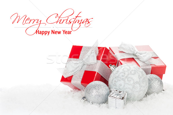 Christmas baubles and red gift boxes over snow Stock photo © karandaev