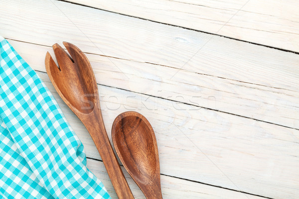 Kitchen utensil over white wooden table background Stock photo © karandaev