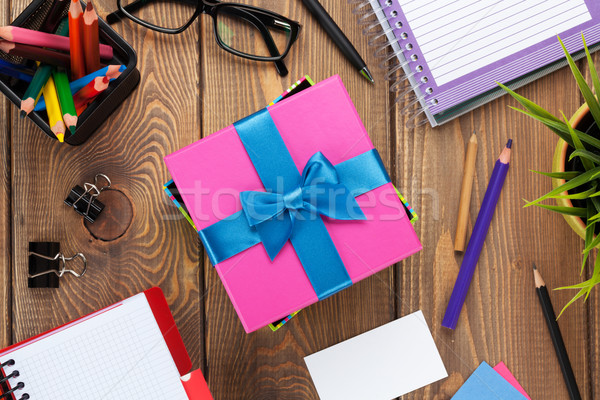 Gift box and office supplies over office table Stock photo © karandaev
