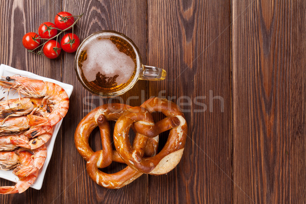 Pretzel, beer mug and grilled shrimps Stock photo © karandaev
