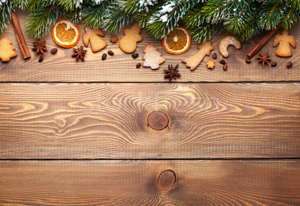 Christmas wooden background with snow fir tree, spices and ginge Stock photo © karandaev