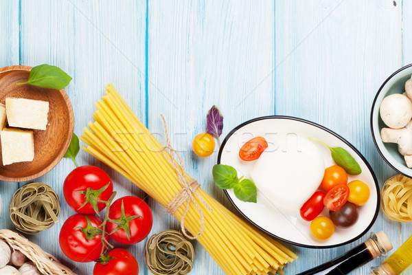 Mozzarella paradicsomok bazsalikom olívaolaj fa asztal felső Stock fotó © karandaev