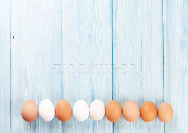 Eggs on wooden table Stock photo © karandaev