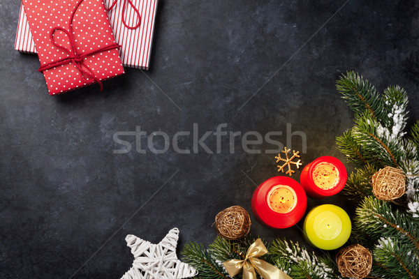 Christmas candles, gifts and snow fir tree Stock photo © karandaev