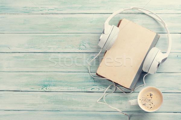 аудио книга наушники кофе старые книги деревянный стол Сток-фото © karandaev