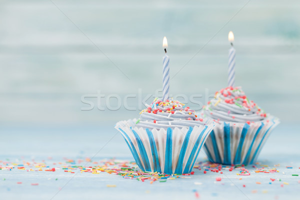 Sweet cupcakes with candles Stock photo © karandaev