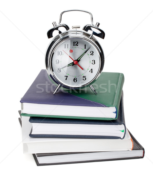 Alarm clock on notepads and books Stock photo © karandaev