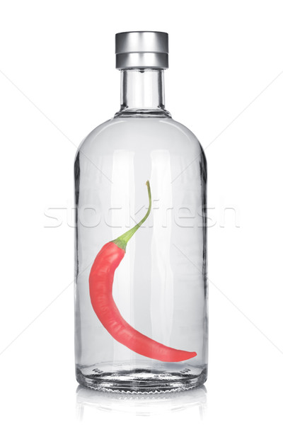 Bottle of vodka with red chili pepper Stock photo © karandaev