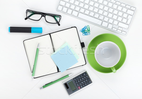 Green coffee cup and office supplies Stock photo © karandaev