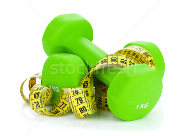 Two green dumbells and tape measure. Fitness and health Stock photo © karandaev