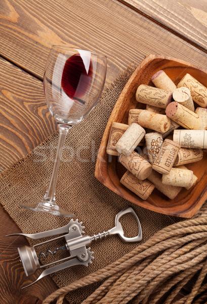 Red wine, corks and corkscrew Stock photo © karandaev