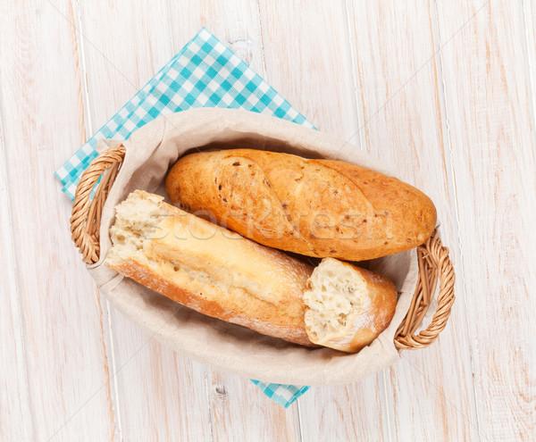 Fresh french bread in basket Stock photo © karandaev