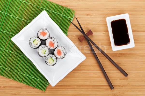 Sushis maki sauce de soja bambou table Photo stock © karandaev