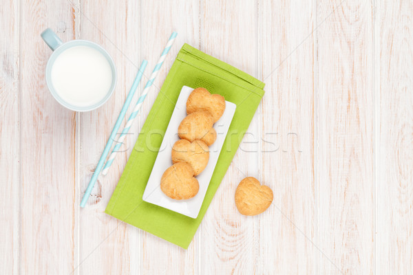 Cup of milk and heart shaped cookies Stock photo © karandaev