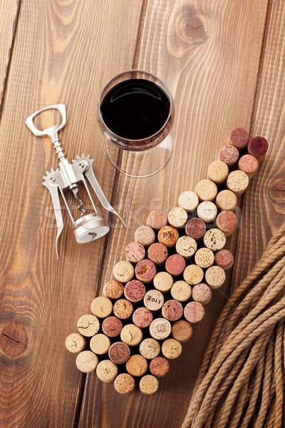 Wine bottle shaped corks, glass of red wine and corkscrew Stock photo © karandaev