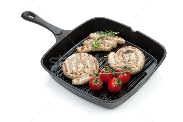 Grilled sausages on frying pan Stock photo © karandaev