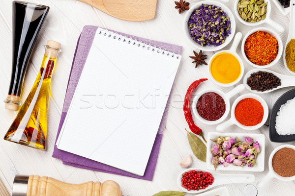 Various spices and condiments on white wooden background Stock photo © karandaev