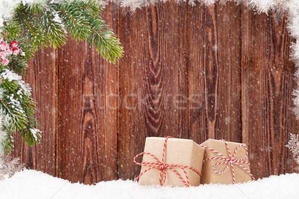 Karácsony ajándékdobozok fenyőfa ág hó kilátás Stock fotó © karandaev