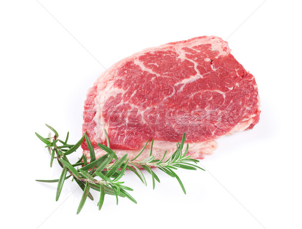 Ruw biefstuk rosmarijn geïsoleerd witte diner Stockfoto © karandaev