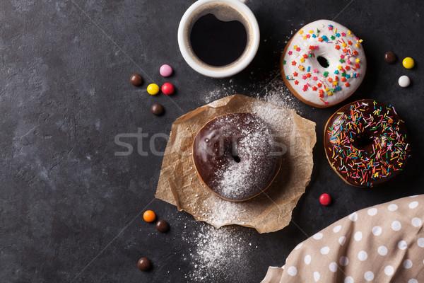 Fánkok kávé kő asztal felső kilátás Stock fotó © karandaev