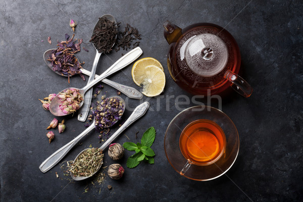 Tea cup and assortment of dry tea in spoons Stock photo © karandaev