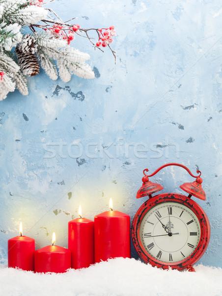 Navidad velas despertador nieve muro de piedra Foto stock © karandaev