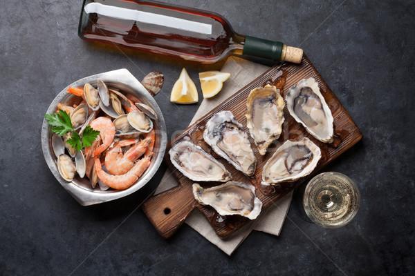 świeże owoce morza białe wino kamień tabeli Zdjęcia stock © karandaev