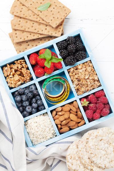 Healthy breakfast set with muesli, berries Stock photo © karandaev