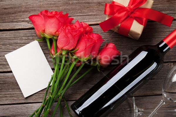 Red roses, wine bottle and Valentine's day gift Stock photo © karandaev